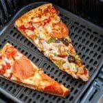 Pizza sliced in air fryer basket