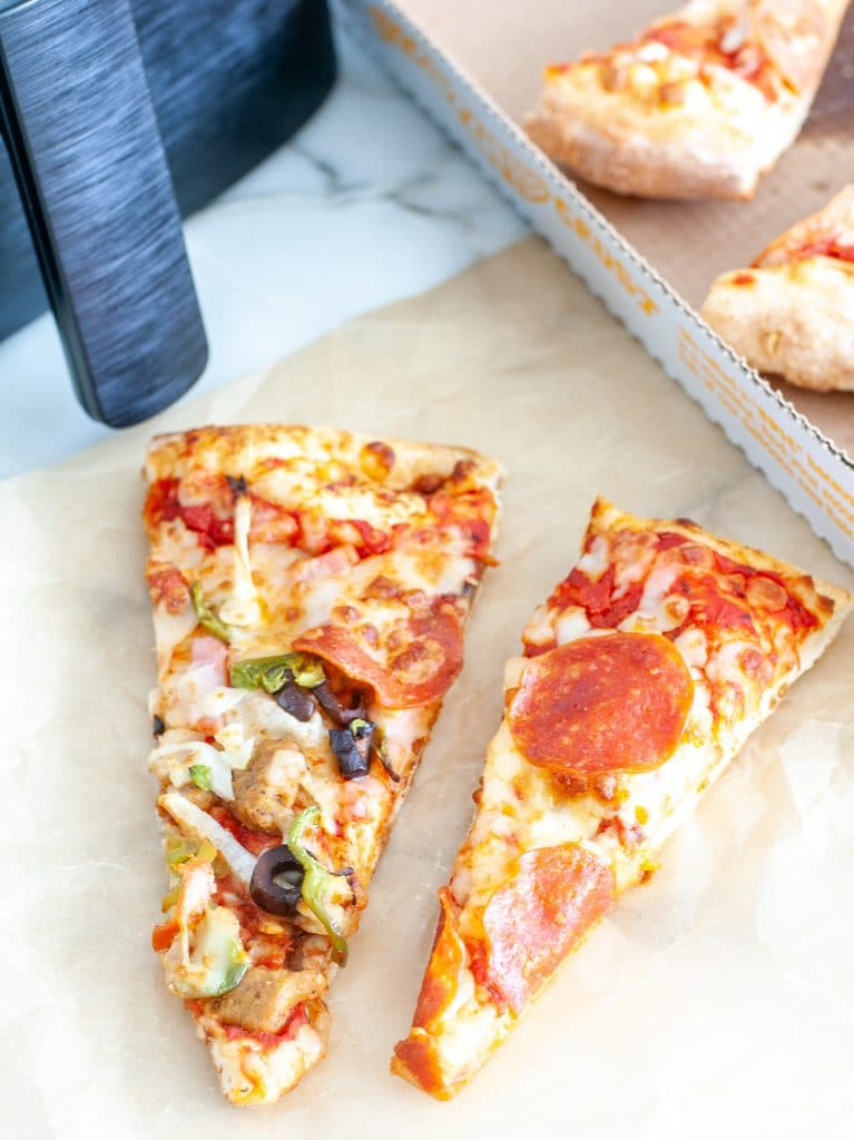 Pizza slices on table.