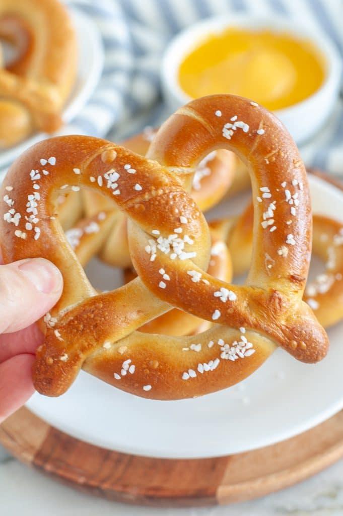 Hand holding a pretzel.