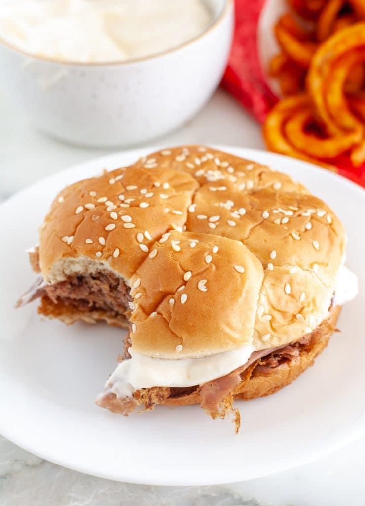 Roast beef sandwich on plate.