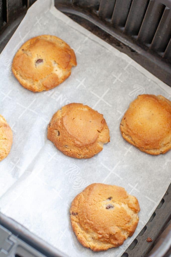 Baked cookies in air fryer basket.
