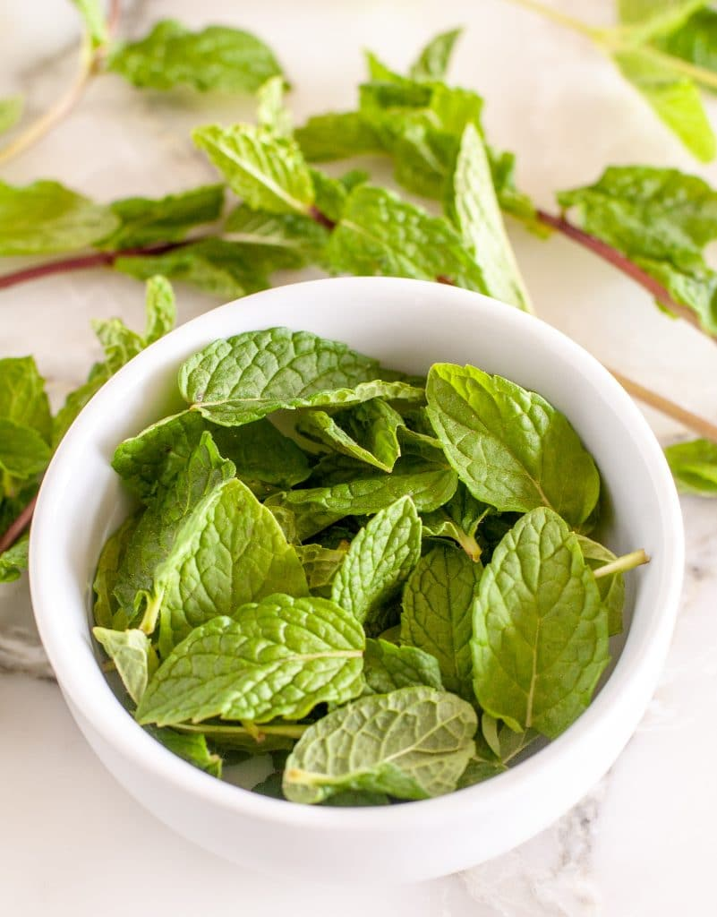 A bowl of mint leaves.