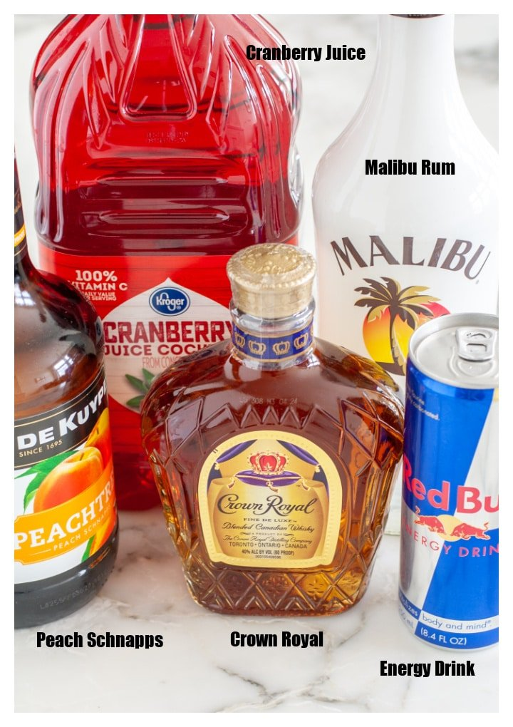 Bottle of whisky, schnapps, rum, energy drink and cranberry juice.