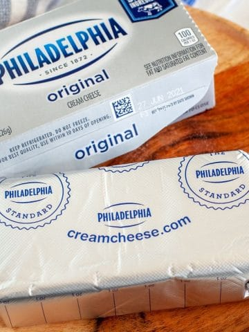 Block of cream cheese on a plate.