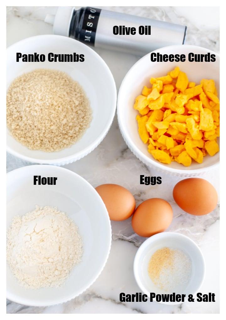 Bowl of cheese curds, panko, flour, eggs and garlic powder.