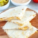 Plate of quesadillas cut into triangles.