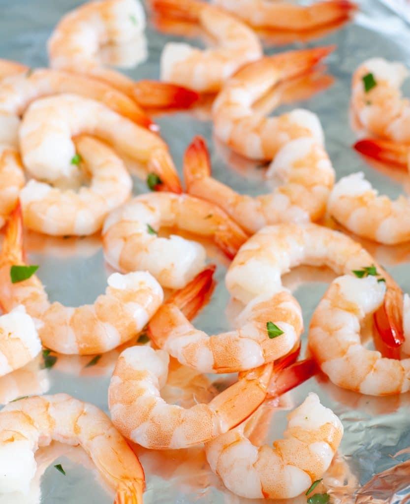 Cooked shrimp on foil.