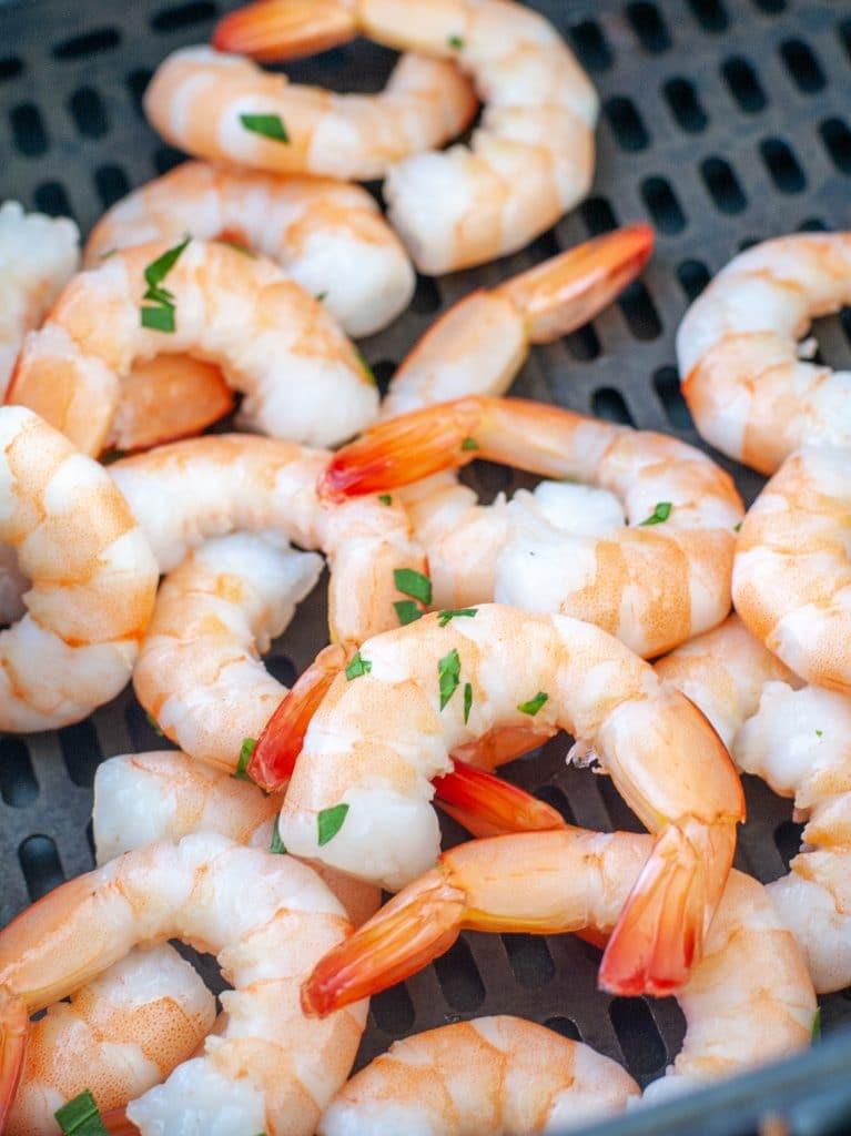 Shrimp in air fryer basket.
