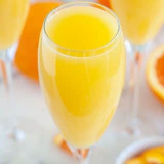 Glass filled with orange juice.