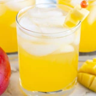 Glasses of juice with diced mango.
