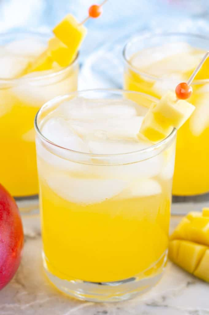 Glass of juice with mangos.