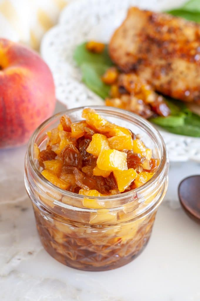 Jar with peach chutney.