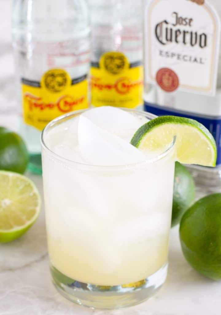 Glass with water and slice of lime.
