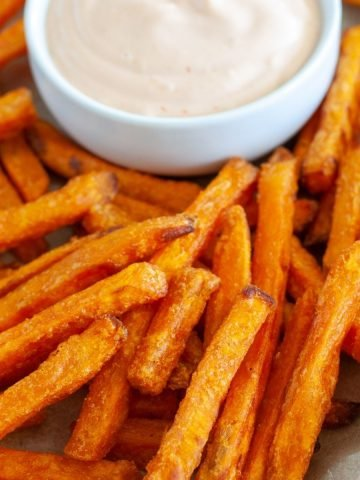 Cooked fries on a plate.