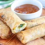 Plate of spring rolls stacked.