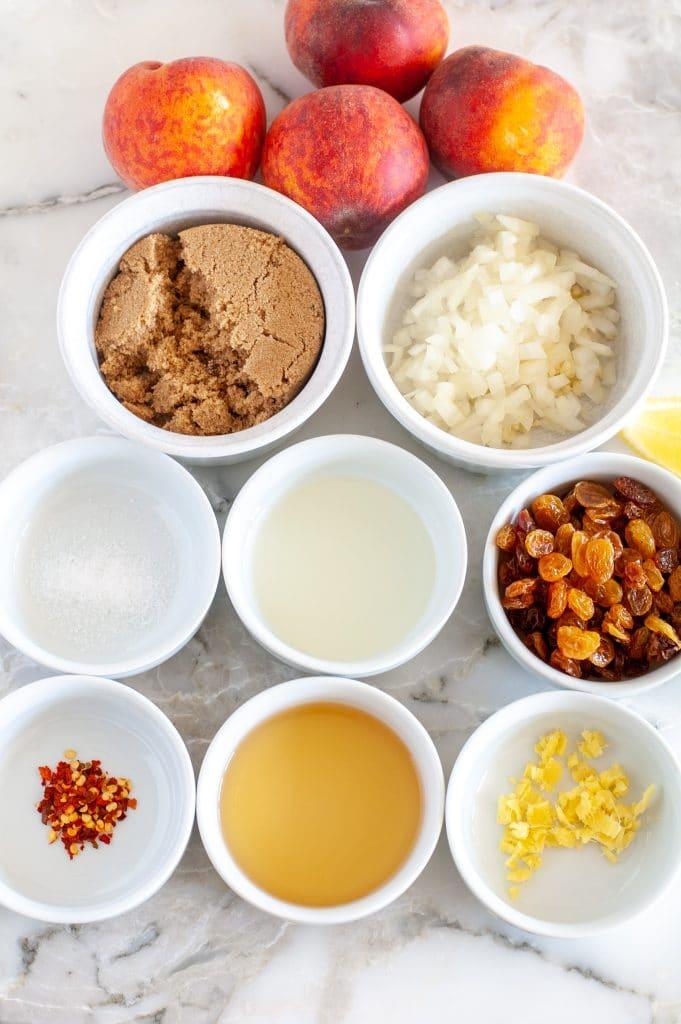 Bowls vinegar, spices, sugar and peaches.