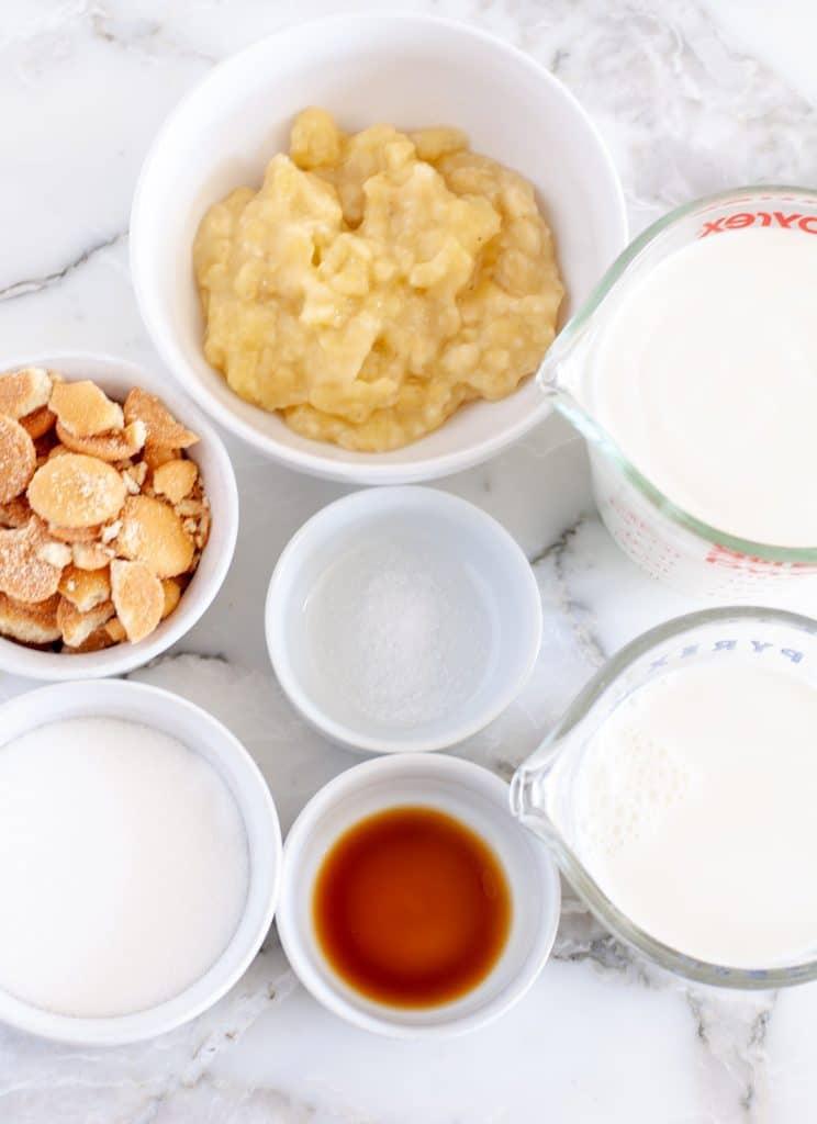 Bowl of mashed banana, sugar, vanilla, cream.