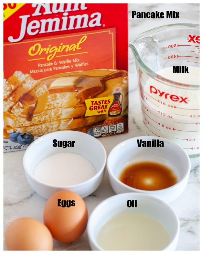 Box of pancake mix, bowl of sugar, oil, milk and eggs.