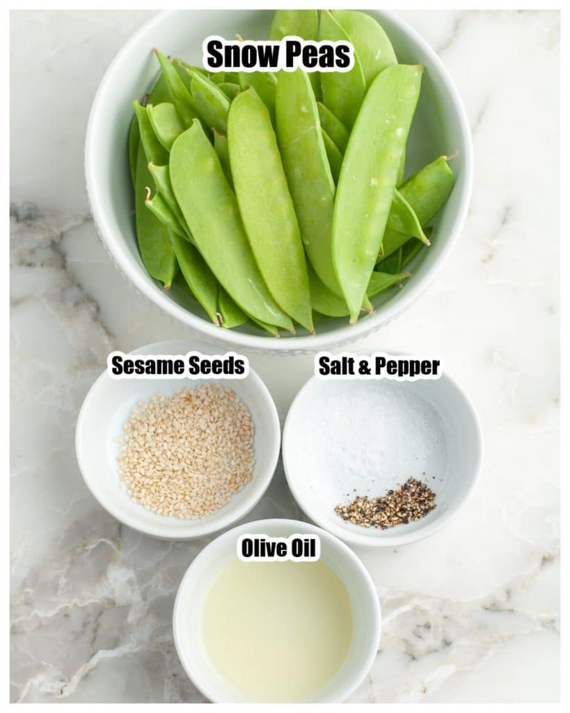 Bowl of snow peas, salt, oil and sesame seeds.