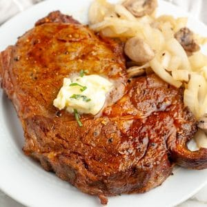 Cooked steak on a plate.