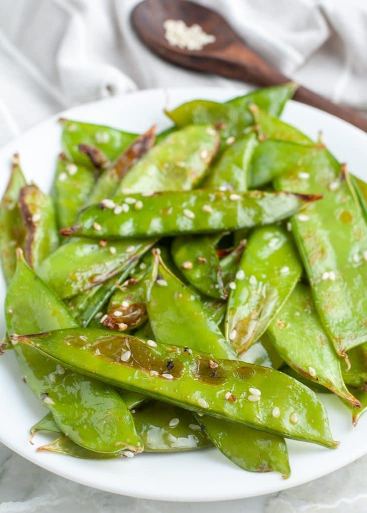 Snap peas on a plate.