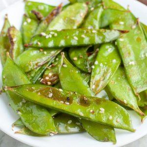 Plate of snow peas and sesame seeds.