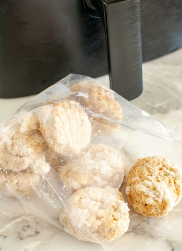 Bag of frozen crab cakes and air fryer.
