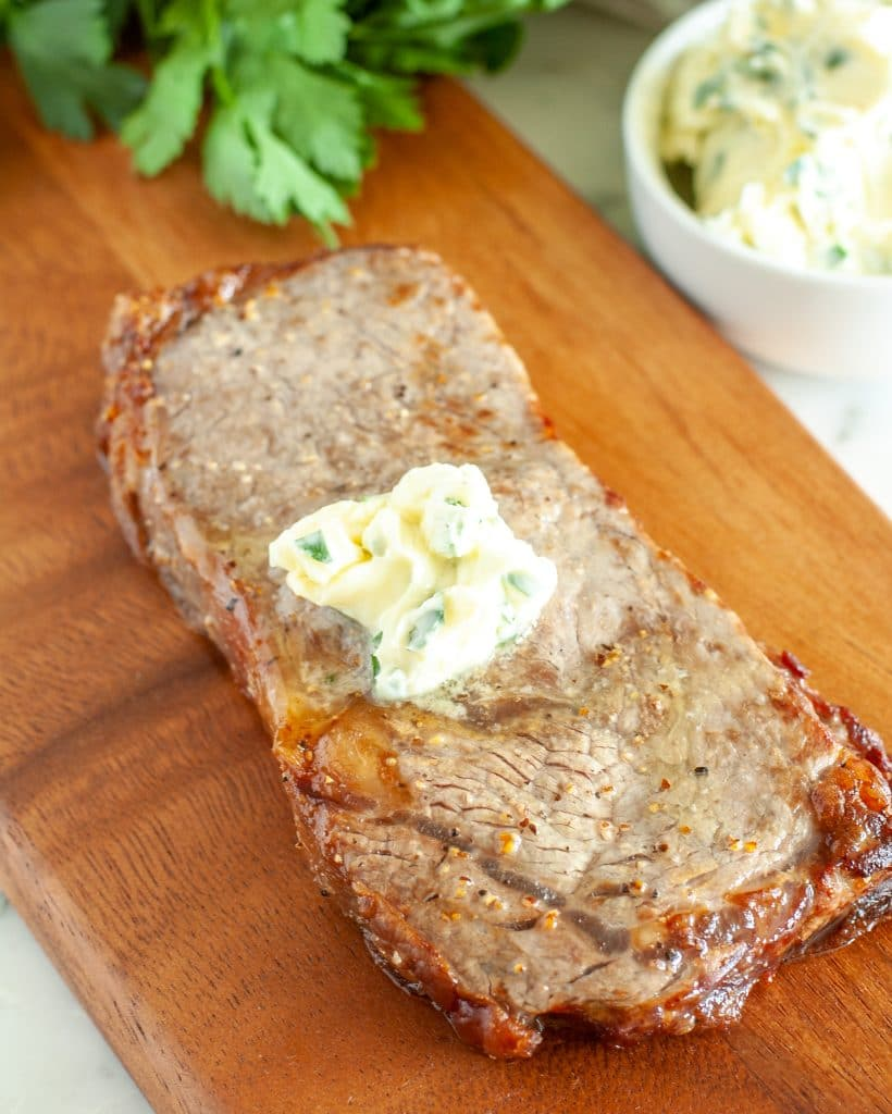 Steak on cutting board.