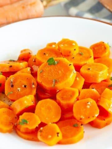 Sliced carrots on a plate.