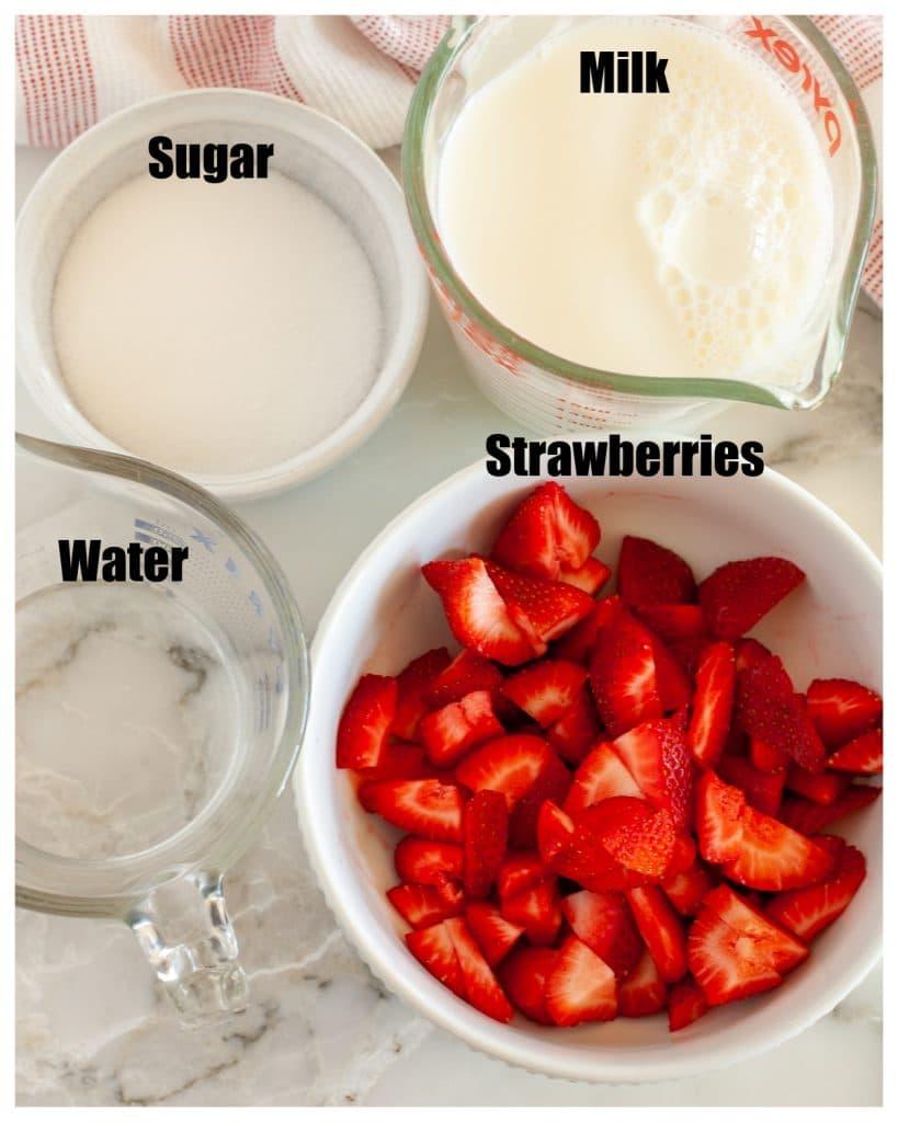 Bowl of strawberries, sugar, water and milk.