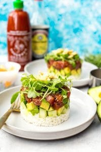 Ahi tuna chunks stacked on avocado and rice.