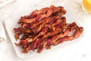 Twisted bacon on plate.
