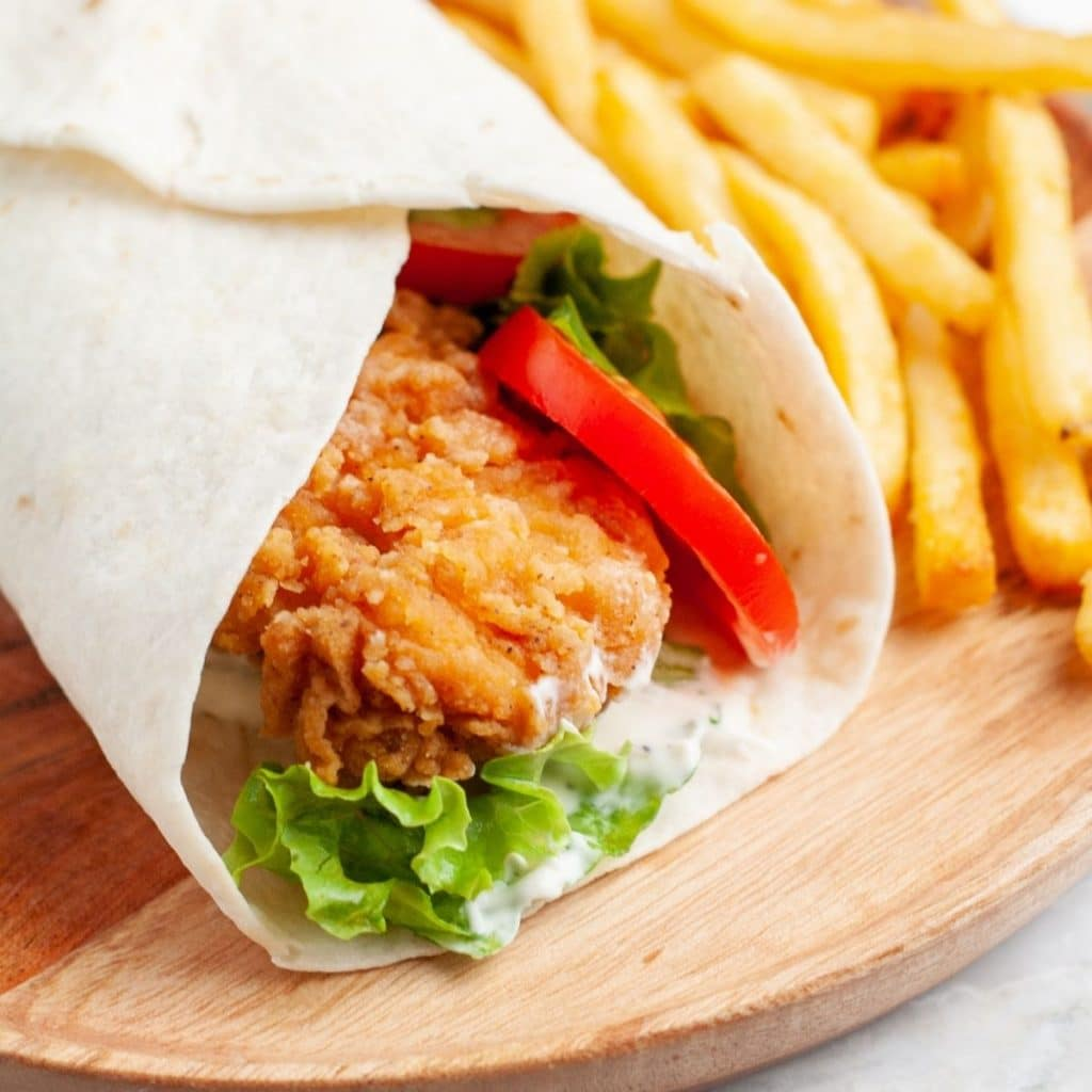 Fried chicken wrap on a plate.