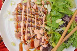 Sliced tuna with sauce.