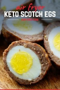 Cooked egg wrapped in sausage.