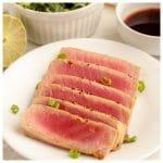 Sliced tuna on a plate.