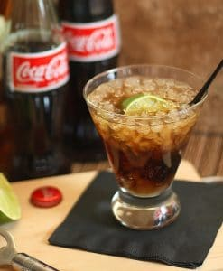 Bottles of Coke with glass and Coke.