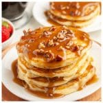 Stack of pancakes with a pecan syrup.
