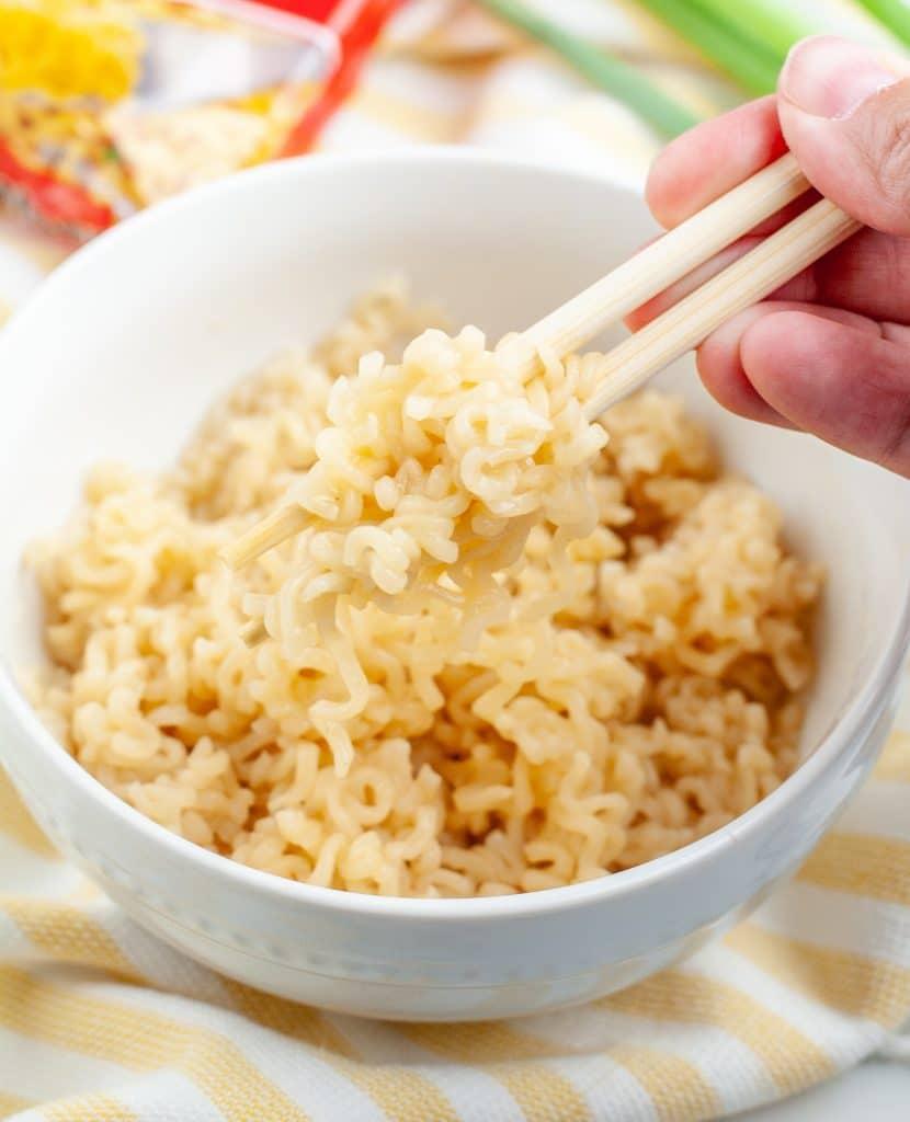 Chopsticks holding noodles.
