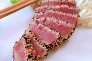 Cooked tuna with sesame crust.