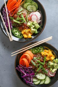 Poke bowls with vegetables and tuna.