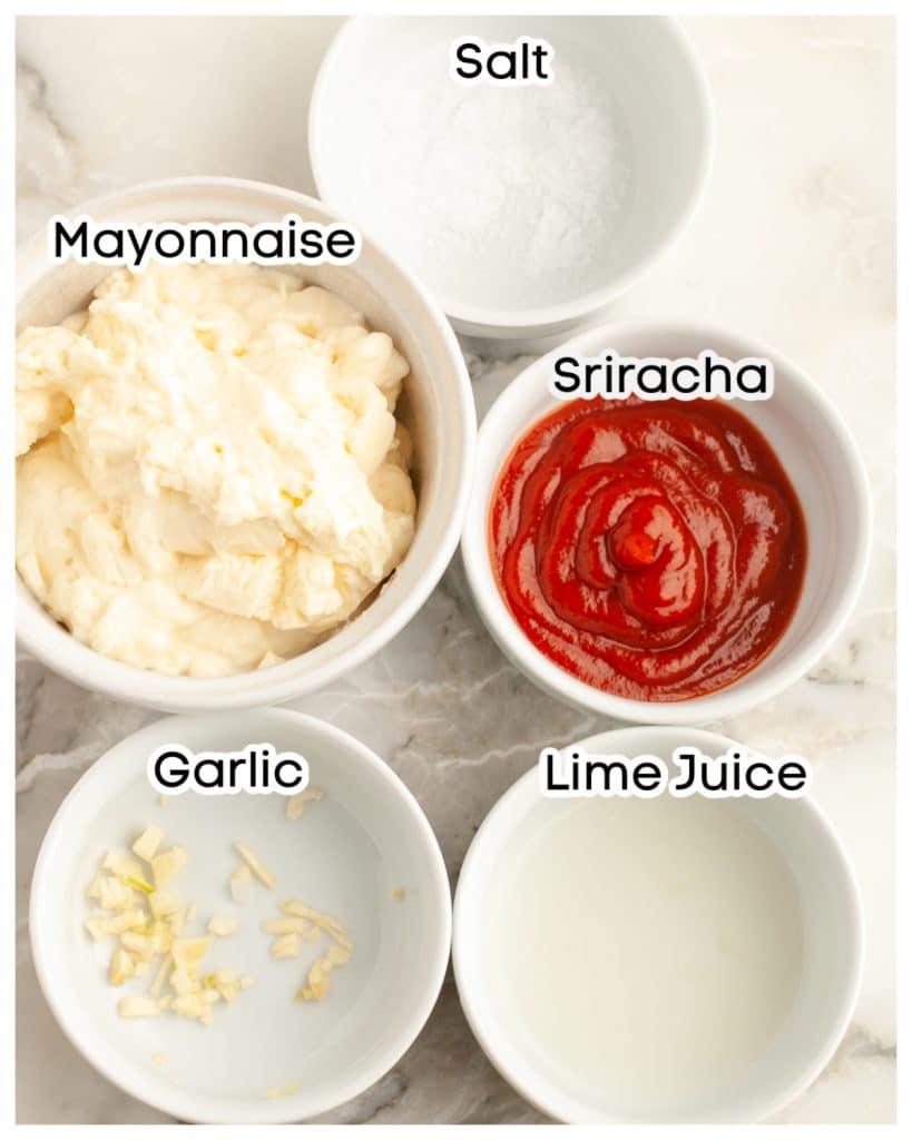 Bowl of mayonnaise, salt, sriracha, garlic, and lime juice.