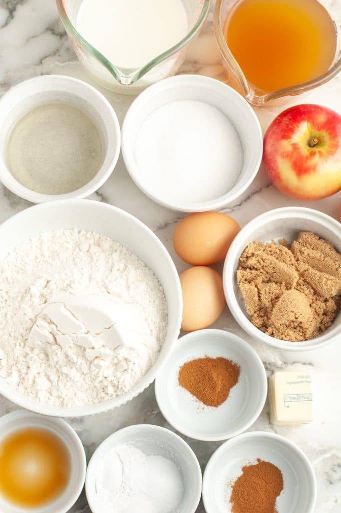Bowls of sugar, flour, vanilla, spices and eggs.