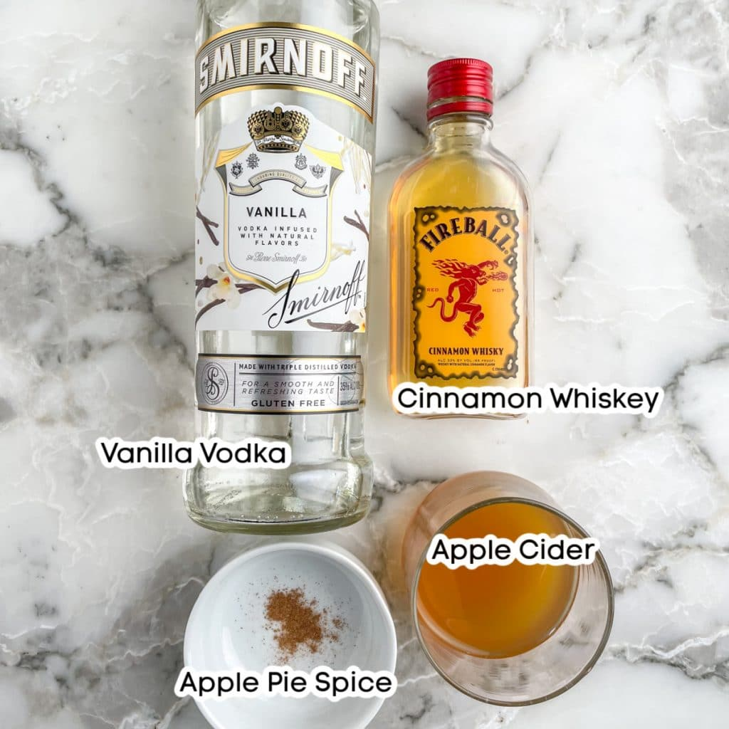 Bottle of vodka and whiskey, cider and apple pie spice.