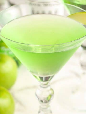 Martini glass with green drink.