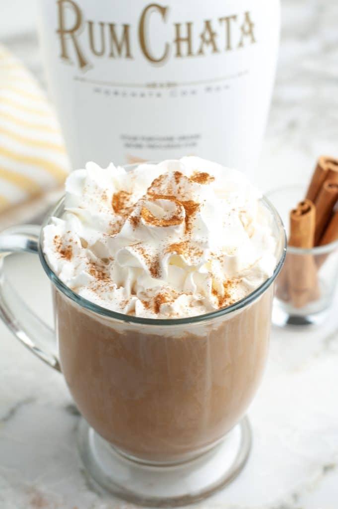 Coffee mug filled with coffee and cream.
