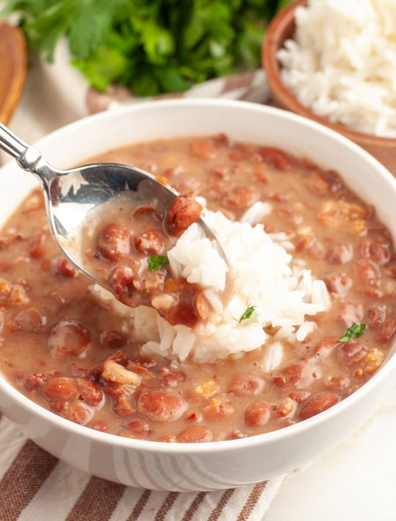 Spoon with bowl of beans.