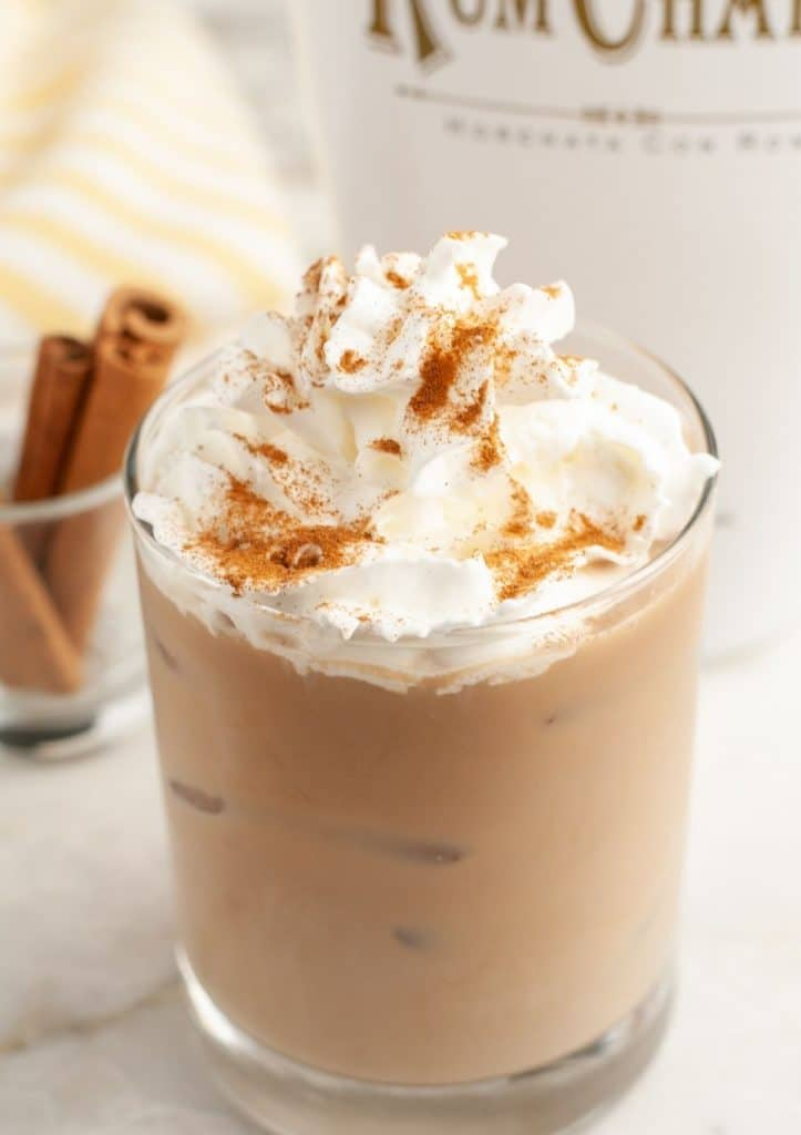 Iced coffee and whipped cream in glass.