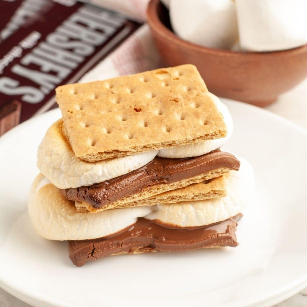 S'mores sitting on a stack of plates.