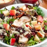 Bowl of salad with chicken.
